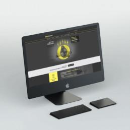 Photo couverture de l'article Dropzone. On y voit un iMac Pro de couleur gris anthracite avec clavier et trackpad de même couleur vu de 3/4. Sur l'écran on y voit le site internet de Dropzone.